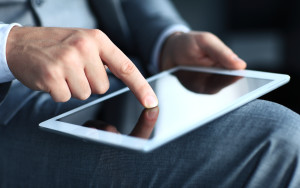 businessman touching screen of a tablet computer.